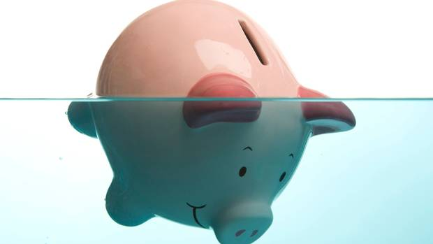 Piggy+bank+face+down+in+water+drowning+in+debt