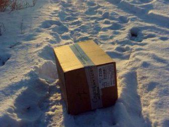 запечатанная коробка снег